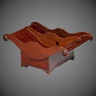 A George III mahogany cheese coaster of wonderful colour, original leather castors.