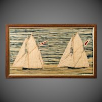 Late 19th Century wool work picture of two gaff rigged cutters one flying Royal Yacht Squadron pennant.