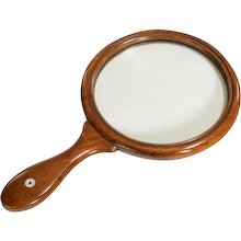 A Victorian mahogany magnifying glass