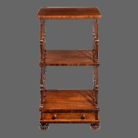 A late Regency mahogany three tier whatnot attributed to Gillows
