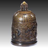 An outstanding Meiji period mixed metal bell casket by the Nogowa foundary,
