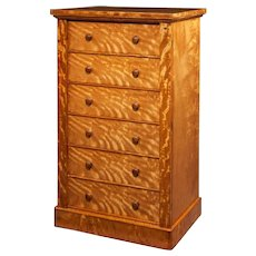 A fine quality early Victorian satinwood wellington chest