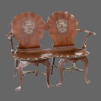 An Irish George III mahogany double chairback hall settee