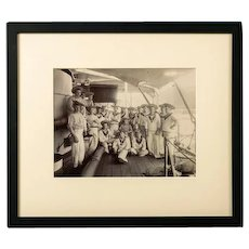 Framed silver gelatin photograph of stokers on the deck of HMS Dido