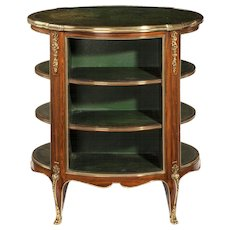 A Napoleon III open kingwood and leather bookcase