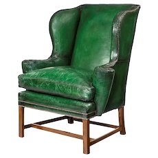 A George III green leather wing arm chair