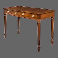 A late Victorian mahogany serving table in the Regency style