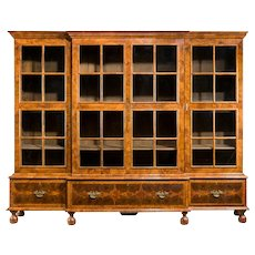 Walnut and oyster veneered breakfront 4 door book case England, 1920