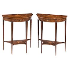 A pair of late Victorian demi lune mahogany console tables