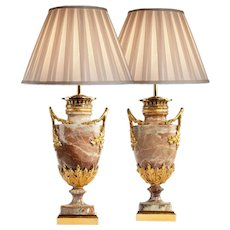 A pair of French marble table lamps