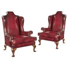A wonderful pair of George II style walnut cabriole legged wing arm chairs