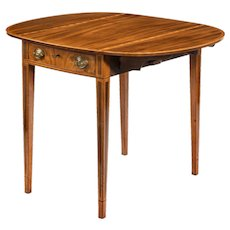 George III oval mahogany and king wood banded Pembroke table