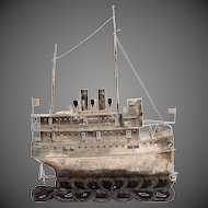 A Chinese silver model of a river steamer, with three tiers of cabins