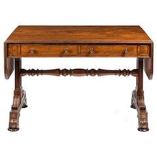 A Regency end support mahogany sofa table