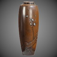 A Meiji period bronze vase by Yoshiharu