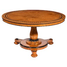 A fine early Victorian amboyna centre table by Taprell and Holland & Sons