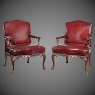 A pair late Victorian Mahogany open arm chairs in the Chippendale taste