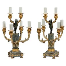 A pair of Napoleon III six-light candelabra