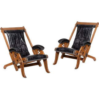 A pair of adjustable reclining Gothic oak library chairs