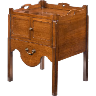 A George III mahogany tray top commode from the Chippendale period