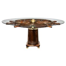 A dining table made from a 19th Century ship's steering wheel