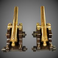 A fine pair of English bronze signal cannon with tapeing barrels set upon original carriages