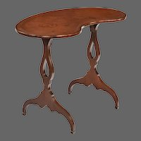Early 19th century Mahogany kidney shaped window or writing table (England, c. 1810)