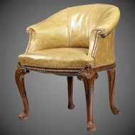 A late Victorian mahogany tub desk chair in the Chippendale style