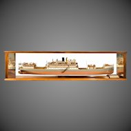 A cased ship's boardroom model of three sister ships,