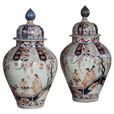 A rare pair of early Edo period Imari vases and covers
