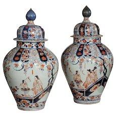 A rare pair of early Edo period Imari vases and covers