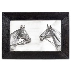 Two silver-plated horse's heads