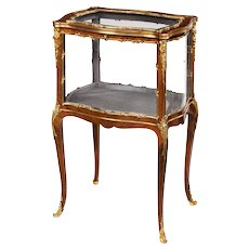 A small late 19th century kingwood and ormolu vitrine