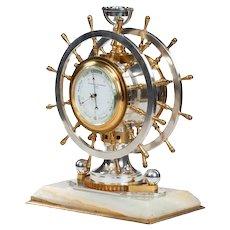 An unusual Victorian double steering-wheel desk clock and barometer