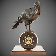A superb Meiji period bronze koro in the form of a dove on a roof tile