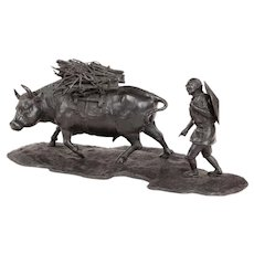 A signed Japanese bronze of a farmer with an ox