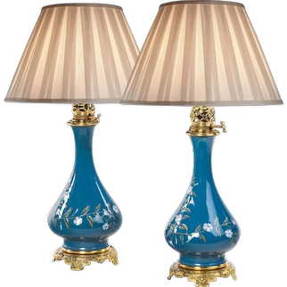 A pair of French pate-sur-pate ceramic oil lamps