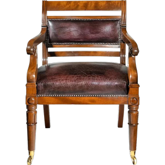 A mahogany library chair in the manner of Henry Holland reputedly made for the United Services Club