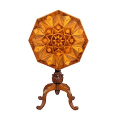 An octagonal indigenous specimen wood marquetry table