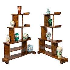 A pair of asymmetrical Art Deco walnut shelves