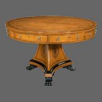A Regency oak drum table