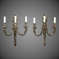 pair of French bronze wall-lights