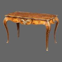 A mid-Victorian walnut bureau plat