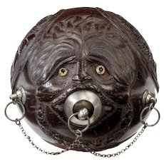 "Coconut shell ""bugbear"" powder flask with silver mounts (Continental, c. 1800)"