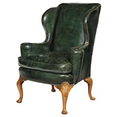An Edwardian walnut wing arm chair
