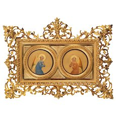 Italian panel of two angels in an ornate gilt wood frame