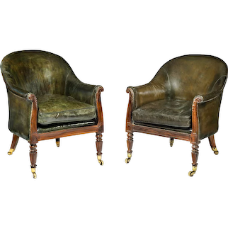 A matched pair of Gillows mahogany library chairs