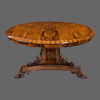 A Regency figured rosewood tilt-top centre table