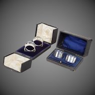 Two boxed pairs of silver napkin rings