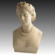 Marble bust of a young lady as Flora by John Adams-Acton